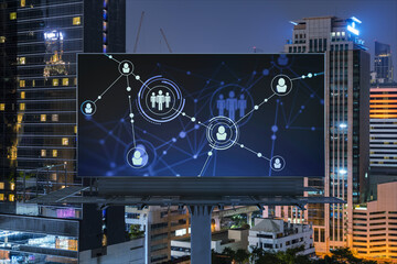 Glowing Social media icons on billboard over night panoramic city view of Bangkok. The concept of networking and establishing new connections between people and businesses in Southeast Asia