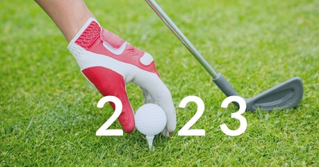 Composition of 2023 number with golf ball placed on golf course