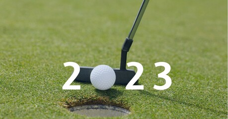 Composition of 2023 number with golf ball and golf club on golf course