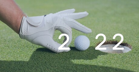 Composition of 2022 number with golf ball placed on golf course
