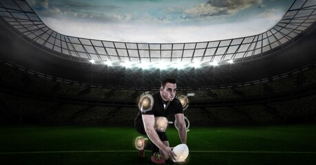 Multiple round scanners over caucasian male rugby player placing a rugby ball against stadium