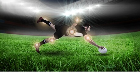 Multiple round scanners over caucasian male rugby player holding a rugby ball diving against stadium