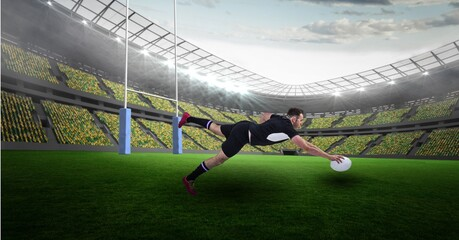 Caucasian male rugby player holding a rugby ball diving against stadium