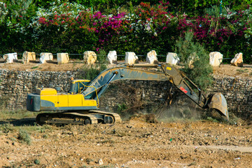 blurred view of big excavators at worksite near new buildings in Israel