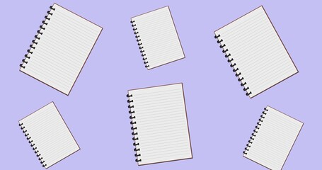 Composition of spiral bound notebooks floating over lilac background