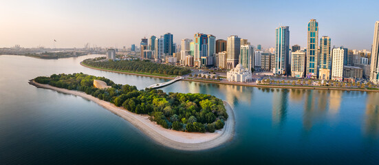 Sharjah aerial panorama above Al Noor island and mosque and downtown rising above Khalid lake