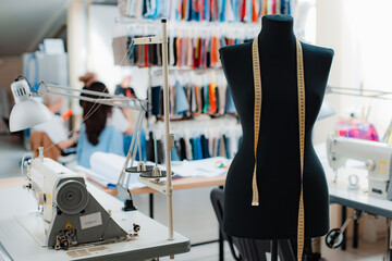 studio mannequin dummystylish fashionable trendy clothes on hangers, dressmaking workplace, tailor shop, sewing workshop