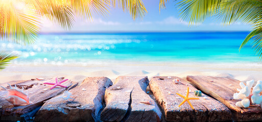 Beach Table With Blurred Ocean And Palm Leaves - Summer Background