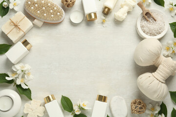 Jasmine flowers and set of spa essentials on white wooden table, flat lay. Space for text