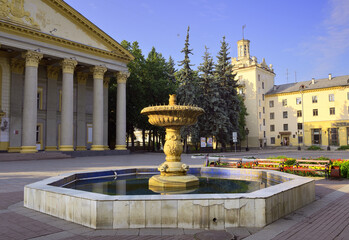 The square near the Gorky House of Culture. An architectural monument of Soviet classicism, a fountain in front of the entrance colonnade of the Corinthian Order. Novosibirsk, Siberia, Russia