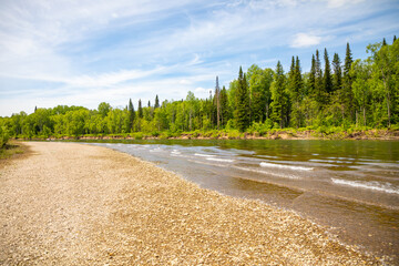 River Taidon flowing through the taiga forests in South Siberia, Russia