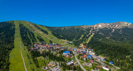 Sheregesh ski lift resort in summer, landscape on mountain and hotels, aerial top view Kemerovo region Russia