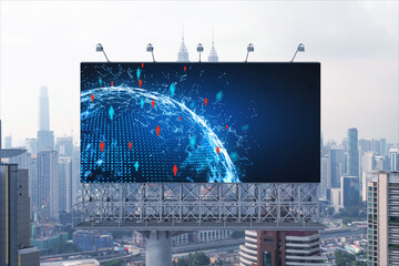 World planet Earth map hologram and social media icons on billboard over panorama city view of Kuala Lumpur, Malaysia, Asia. The concept of people networking and connections.
