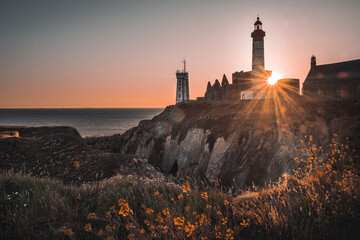 Scenic view of Pointe Saint-Mathieu lighthouse and abbey, Finistere, Brittany, France at sunset