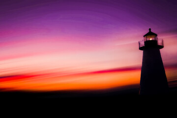 Silhouette of lighthouse against a colorful sky