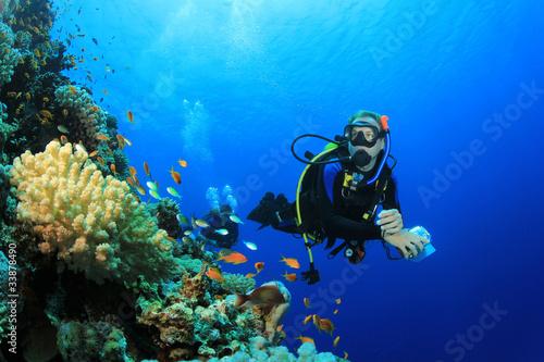 Scuba Diver explores Coral Reef in Tropical Sea