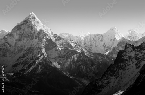 Spectacular mountain scenery of Ama Dablam on the Mount Everest Base Camp trek through the Himalaya, Nepal in stunning black and white