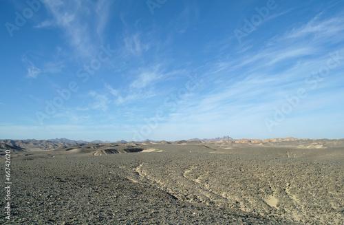desert covered by black stones