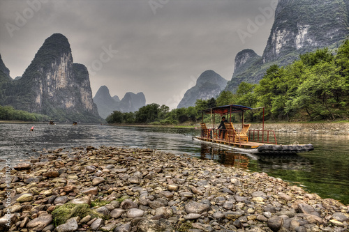 Bamboo raft on Lijiang River, amid karst hills, Guangxi, China.