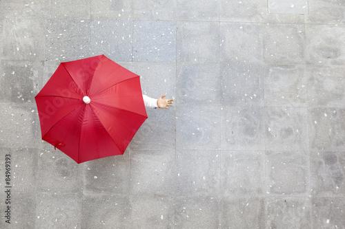 Man holding a red umbrella