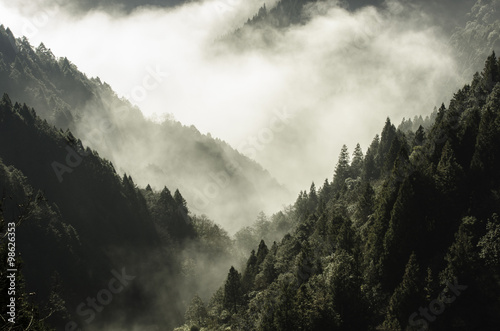 High mountain in mist and cloud