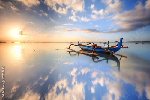 morning sun in Bali, Indonesia. Traditional fishing boats at Sanur beach