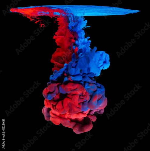 Colored ink in water creating abstract shape