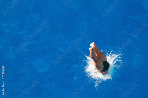 Splash. Diver entering the water. Shot from above