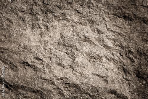 Kamienny tło, skały ścienny tło z szorstką teksturą. Abstrakcyjna, nieczysty i teksturowana powierzchnia z kamienia. Szczegóły natury skał.