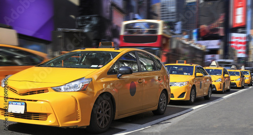 Yellow Taxis in Times Square is a major commercial intersection and neighborhood in Midtown Manhattan, New York City