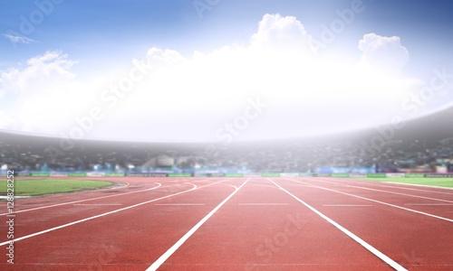 Running track in a stadium under bright sunlight