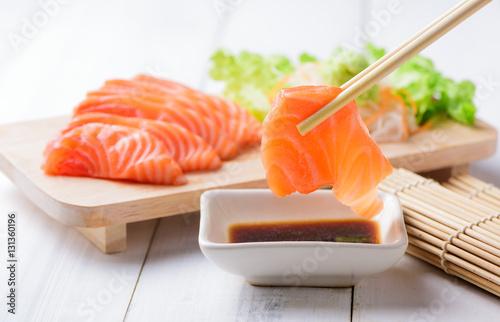 salmon sashimi with chopsticks.