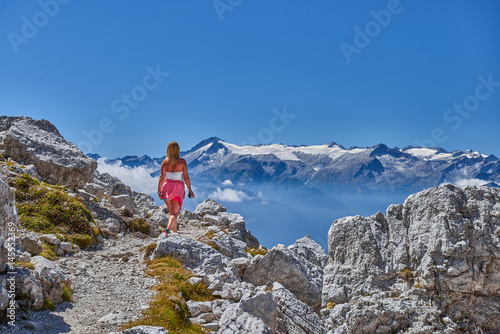 Women Travel nature in the mountains,Woman watching the dolomiti mountains