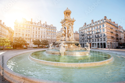 Morning view on Jacobins square and beautiful fountain in Lyon city, France