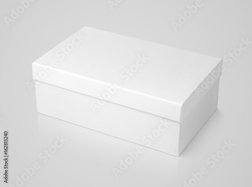 Closed shoe white paper box on gray background with clipping path