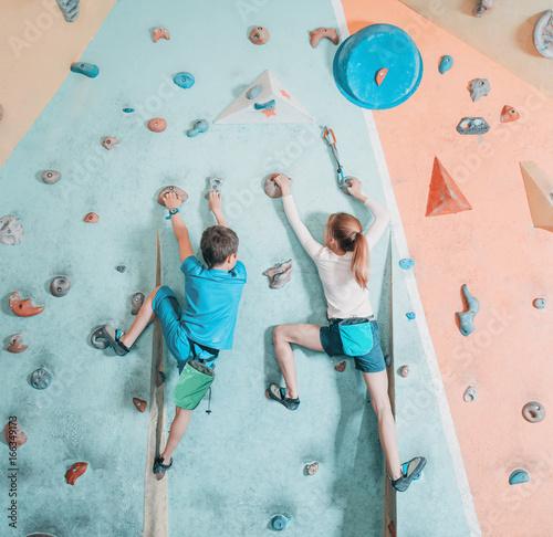 Two children climbing in gym.