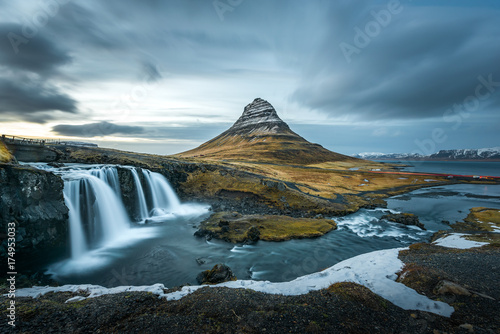Beautiful landscape of Kirkjufellsfoss with background of remarkable mountain, landmark of iceland during late winter