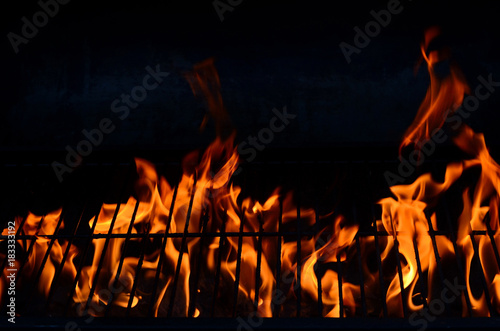 Black background with flames (red-hot grill)