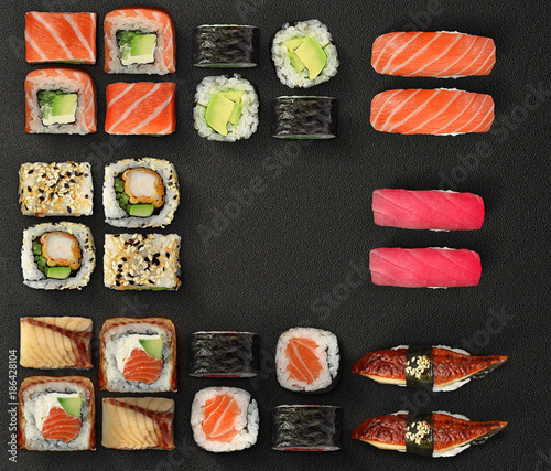 Kuchnia japońska. Sushi i rolki ustawione na ciemnym tle.