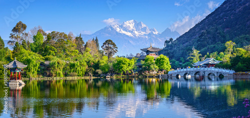 Black Dragon Pool and Jade Dragon Snow Mountain. It's a famous pond in the scenic Jade Spring Park (Yu Quan Park) located at the foot of Elephant Hill, old Town of Lijiang in Yunnan, China.