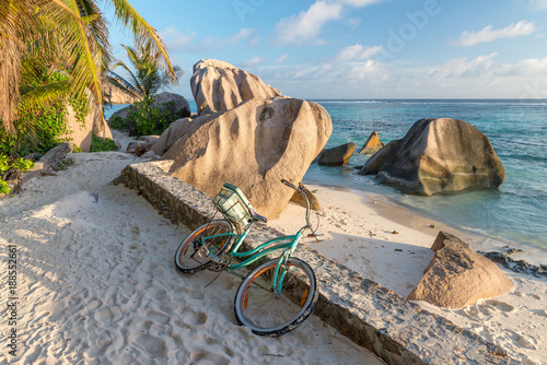 Bike parked on a beautiful tropical beach. Holiday concept
