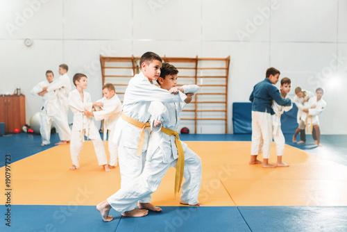 Kid judo, childrens training martial art in hall