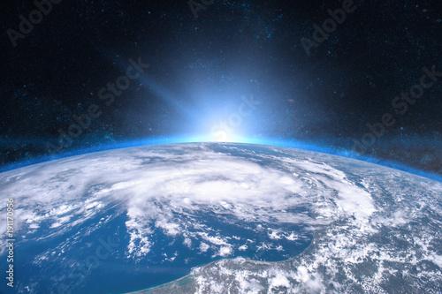 Ziemia w kosmosie. Niebieski wschód słońca. Elementy tego obrazu dostarczone przez NASA.