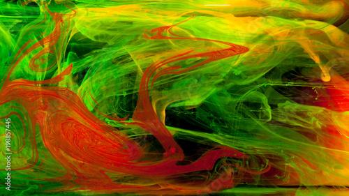 Abstrakcja mieszanki wielokolorowe farby w wodzie na czarnym tle