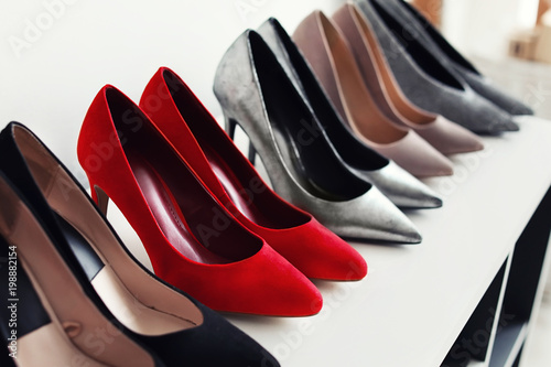 High heeled shoes on shelf in store