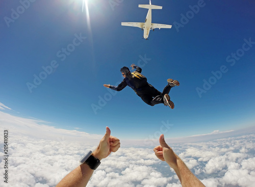 Skydiver Cloudscape jump out of plane