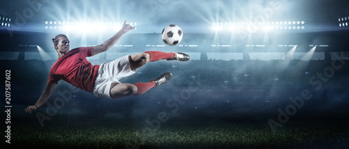 Soccer player in action on stadium background.