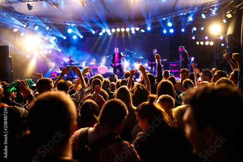 Crowd of young people on concert