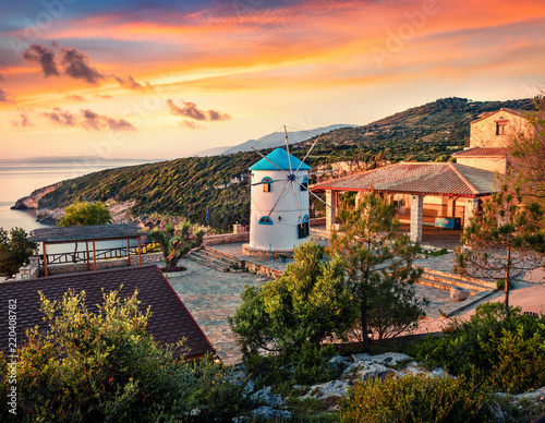 Fabulous morning scene of the contryside with Windmill. Colorful spring sunrise on the Zakynthos island, Korithi location, Ionian Sea, Greece, Europe. Beauty of countryside concept background.