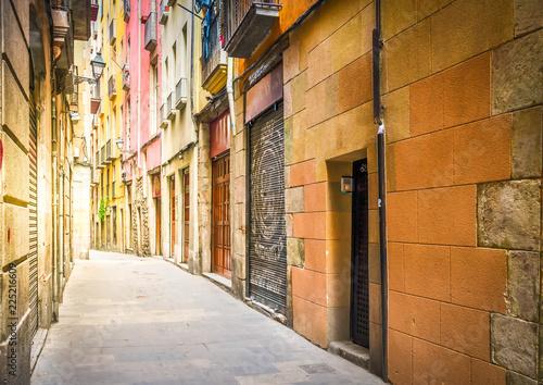 narrow street in Barrio Gotic quarter of Barcelona, Spain, toned